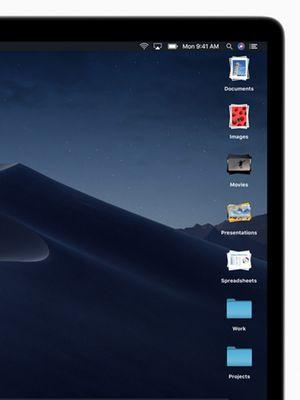Fitur Stacks merapikan tampilan desktop MacOS Mojave dengan mengelompokkan aneka item berdasarkan jenisnya.