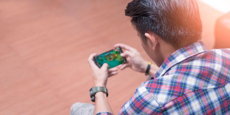 Ilustrasi bermain game di smartphone