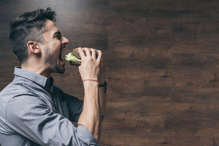 Ilustrasi pria makan burger