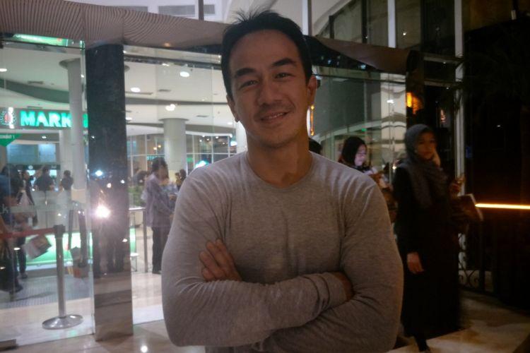 Joe Taslim saat menghadiri gala premier film Chrisye di XXI Epicentrum, Kuningan, Jakarta Selatan, Jumat (1/12/2017) malam.