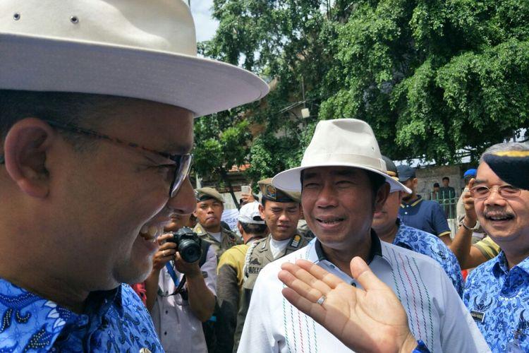 Gubernur DKI Jakarta Anies Baswedan dan Wakil Ketua DPRD DKI Jakarta Abraham Lunggana berada di kawasan Tanah Abang, Jumat (22/12/2017).