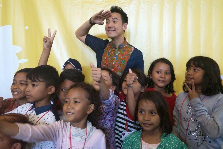 Daniel Mananta dalam kegiatan perjamuan Makan Siang Natal di Seminari Wacana Bhakti, SMA Kolese Gonzaga, Jakarta Selatan, Senin (25/12/2017).