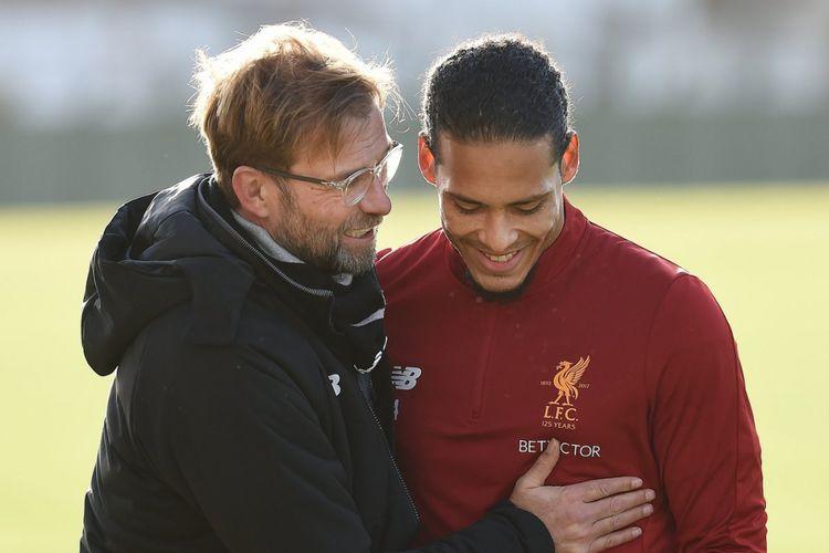 Virgil van Dijk bersama pelatih Liverpool Juergen Klopp.