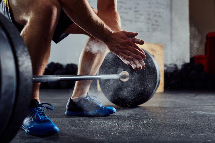 Ilustrasi olahraga mengangkat beban