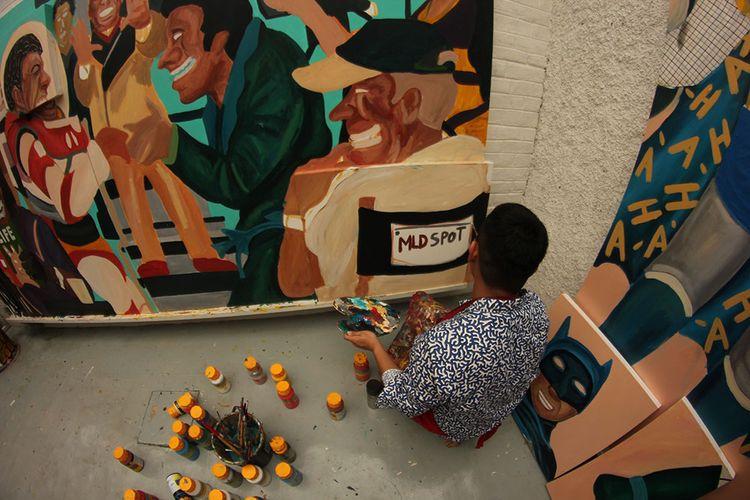Naufal saat sedang melukis.