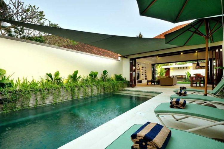 Desain kolam renang Chris & Jennifer Villa di Bali karya OG Architects.