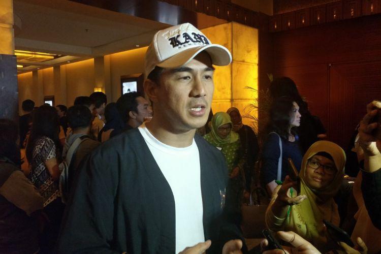 Joe Taslim menghadiri gala premiere film Mile 22, yang dibintangi oleh Iko Uwais di Plaza Senayan XXI, Jakarta Selatan, Senin (20/8/2018) malam.