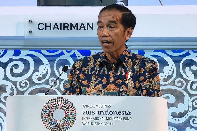 Presiden Joko Widodo saat membuka Rapat Pleno Pertemuan Tahunan IMF-Bank Dunia 2018 di Bali Nusa Dua Convention Center (BNDCC) di Nusa Dua, Bali, Jumat (12/10/2018).