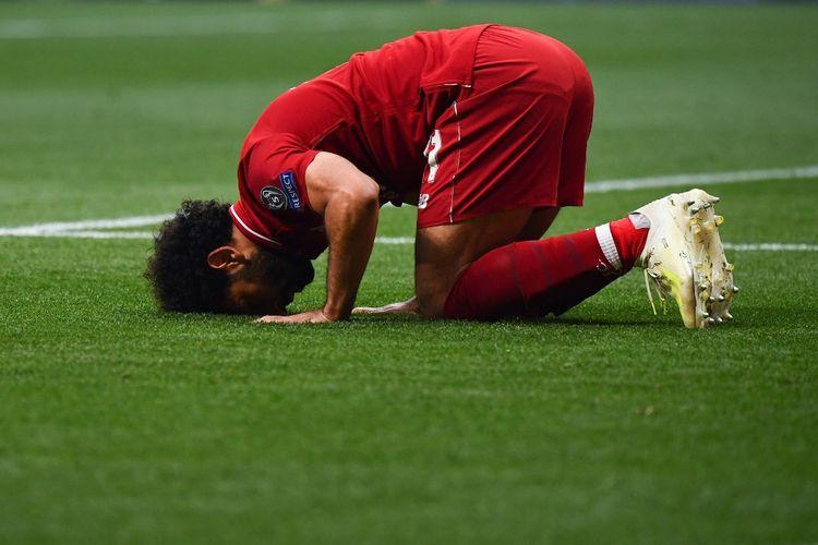 Mohamed Salah melakukan selebrasi usai mencetak gol penalti pada laga Tottenham Vs Liverpool, di Stadion Wanda Metropolitano, Madrid, Spanyol, Sabtu (1/6/2019).