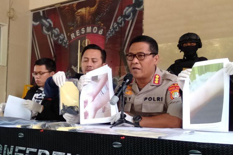 Kabid Humas Polda Metro Jaya Komisaris Besar Argo Yuwono merilis kasus penyekapan dan pemerasan oleh pengemudi taksi online di Mapolda Metro Jaya, Sabtu (29/6/2019)