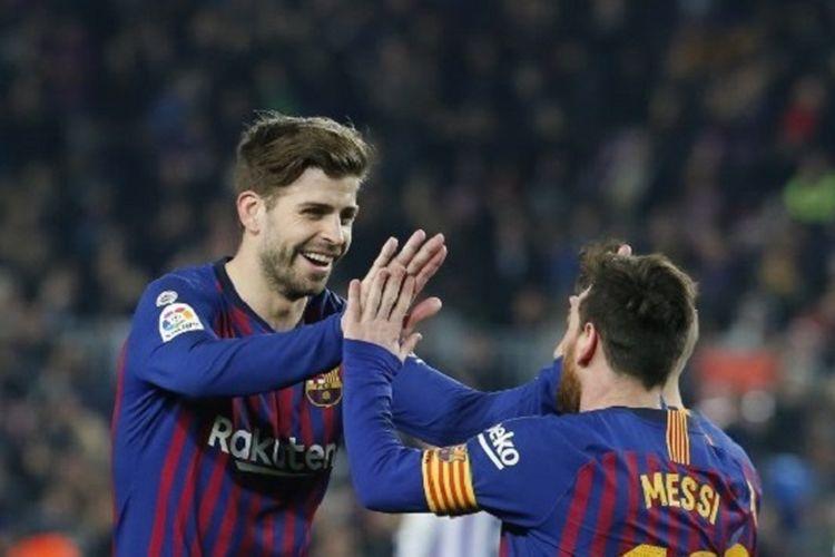Gerard Pique merayakan gol Lionel Messi pada pertandingan Barcelona vs Real Valladolid dalam lanjutan La Liga Spanyol di Stadion Camp Nou, 16 Februari 2019.