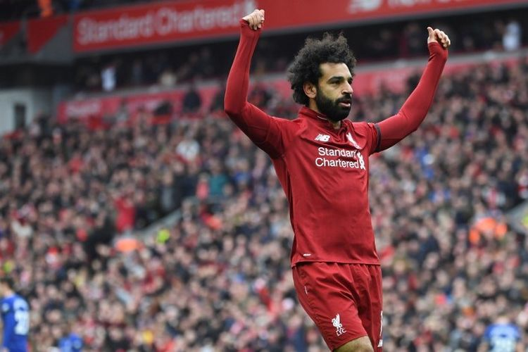 Mohamed Salah merayakan golnya dalam pertandingan Liverpool vs Chelsea dalam lanjutan Liga Inggris di Stadion Anfield, 14 April 2019.