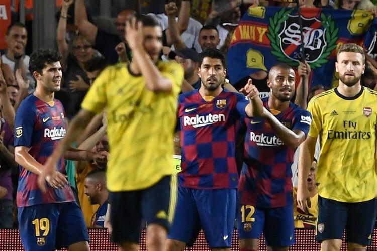 Luis Suarez merayakan gol kemenangan timnya pada pertandingan Barcelona vs Arsenal dalam Trofi Joan Gamper di Stadion Camp Nou, 4 Agustus 2019.