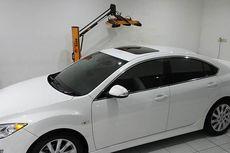Perlukah Mencuci Mobil yang Sudah Lapis Couting?