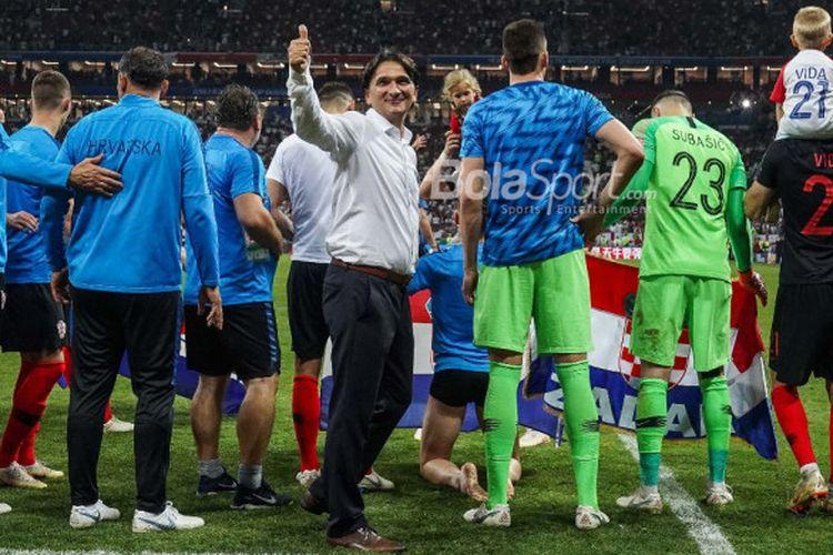 Pelatih Kroasia, Zlatko Dalic, merayakan kemenangan timnya atas Inggris di semifinal Piala Dunia 2018 di Luzhniki Stadium, Kamis (12/7/2018).