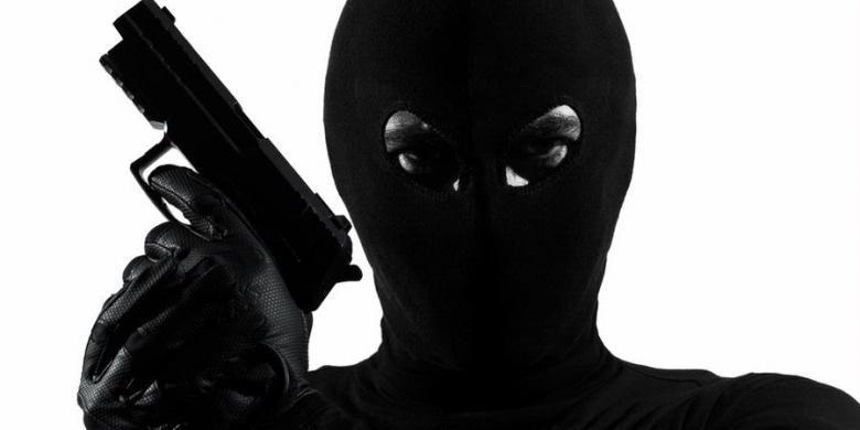 Ilustrasi penjahat bersenjata api.