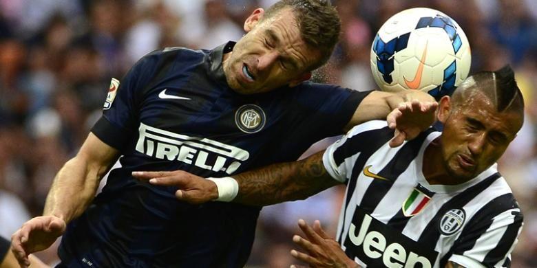 Penampilan gelandang Juventus, Arturo Vidal, saat melawan Inter Milan dalam lanjutan Serie-A, Sabtu (14/9/2013).