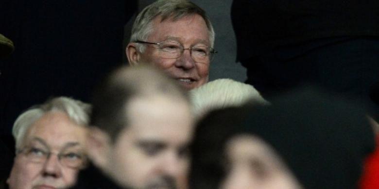 Sir Alex Ferguson menyaksikan laga Manchester United melawan Tottenham Hotspur pada 1 Januari 2014.