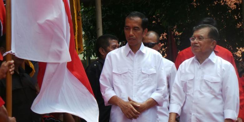 Capres-Cawapres Joko Widodo dan Jusuf Kalla usai deklarasi, Senin (19/5/2014)