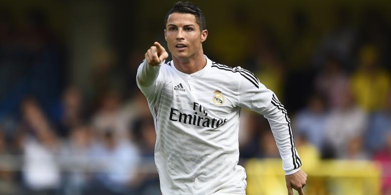 Ekspresi gelandang Real Madrid Cristiano Ronaldo usai mencetak gol ke gawang Villarreal, pada laga Primera Division, di El Madrigal, 27 September 2014.