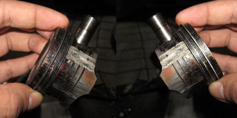Piston yang sudah tergores dan menyebabkan oli rembes dan membasahi busi serta ruang bakar.