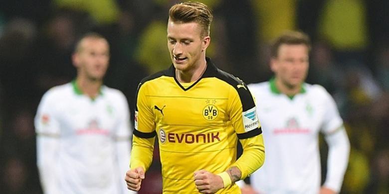 Marco Reus mencetak 2 gol kemenangan Borussia Dortmund di kandang Werder Bremen, Sabtu (31/10/2015).