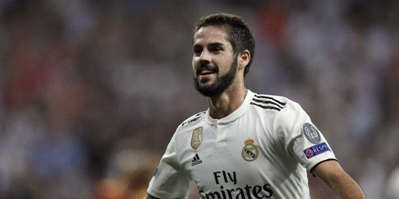 Gelandang Real Madrid, Isco, melakukan selebrasi setelah menjebol gawang AS Roma pada laga Liga Champions di Santiago Bernabeu, Rabu (19/9/2018)