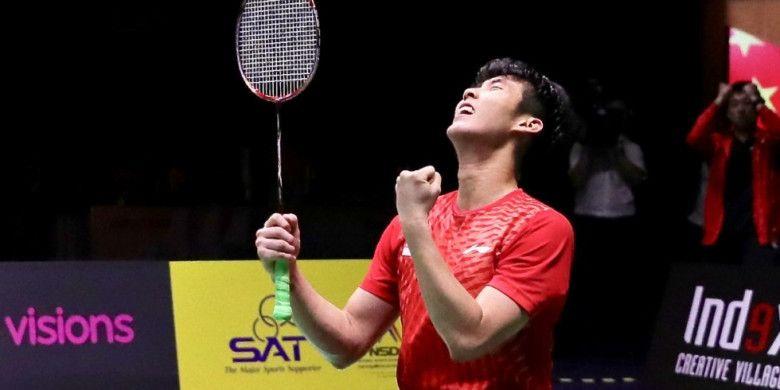 Pebulu tangkis tunggal putra Singapura, Loh Kean Yew, bereaksi setelah memastikan diri menjuarai Thailand Masters 2019 di Indoor Stadium Hua Mark, Bangkok, Thailand, Minggu (13/1/2019).