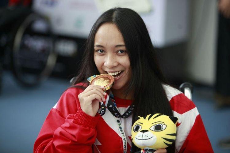 Laura Aurelia Dinda, tampil di nomor 100 meter gaya bebas di kelas S6, menjadi atlet pertama bagi Indonesia yang menyumbang medali emas di ajang ASEAN Para Games, Senin (18/09/2017).