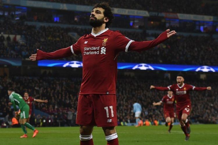 Mohamed Salah merayakan gol Liverpool ke gawang Manchester City pada laga perempat final Liga Champions di Stadion Etihad, Selasa (10/4/2018).