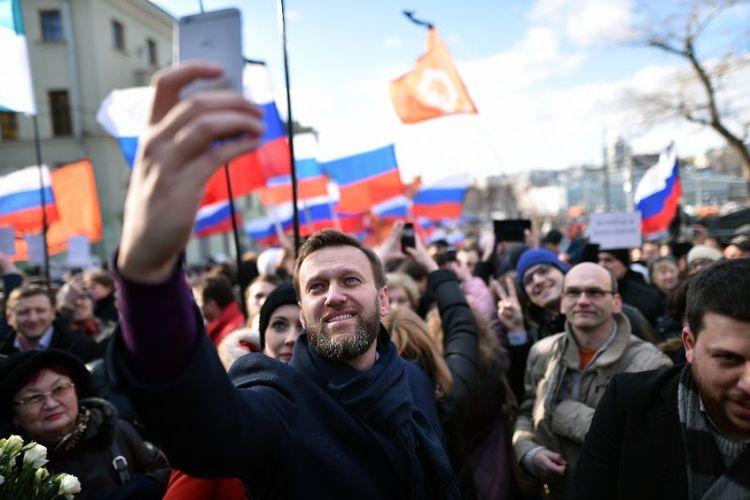 Pemimpin kubu oposisi Rusia Alexei Navalny dalam sebuah aksi di Rusia.