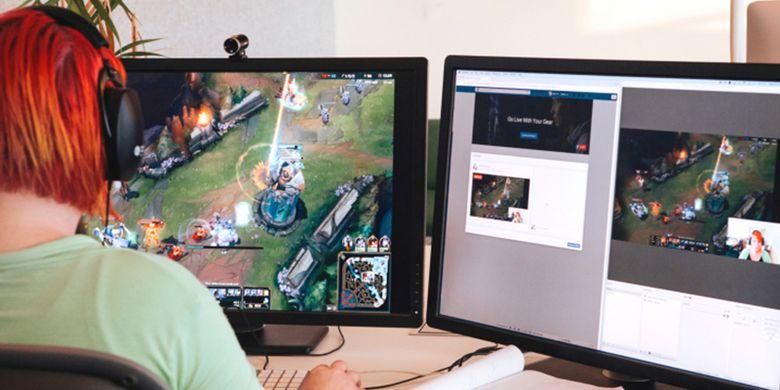 Ilustrasi pemain game melakukan streaming gameplay lewat Facebook Live desktop.