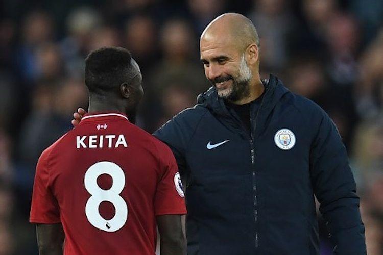Pep Guardiola tampak berbincang dengan Naby Keita seusai laga Liverpool vs Manchester City di Stadion Anfield, 7 Oktober 2018.