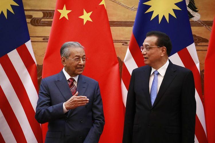 PM Malaysia Mahathir Mohamad dan PM China Le Keqiang.
