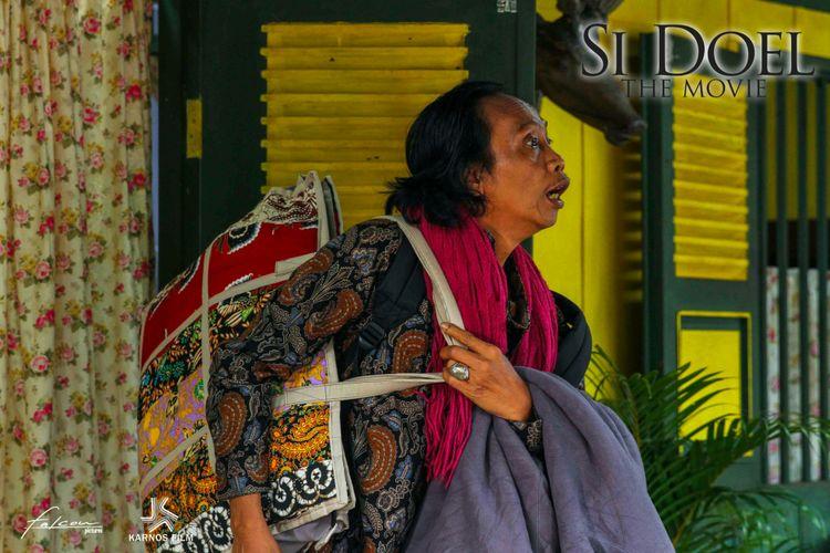 Tokoh Mandra yang diperankan H.Mandra YS dalam film Si Doel The Movie.
