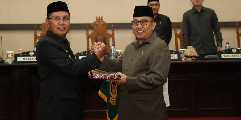 Wali Kota Makassar Danny Pomanto usai Rapat Paripurna Penyampaian LKPJ tahun anggaran 2018 dan LKPJ akhir masa jabatan Walikota Makassar di gedung DPRD Makassar, Rabu (10/4/2019), Danny