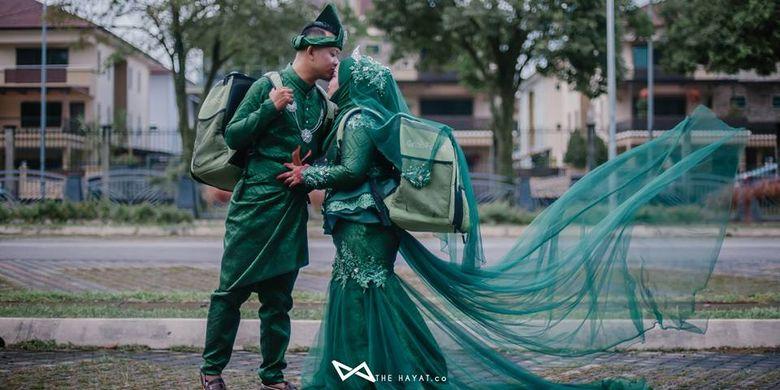 Pasangan Malaysia, Nur Atiqah dan Mohamad Afandi melakukan foto pernikahan bertema GrabFood.