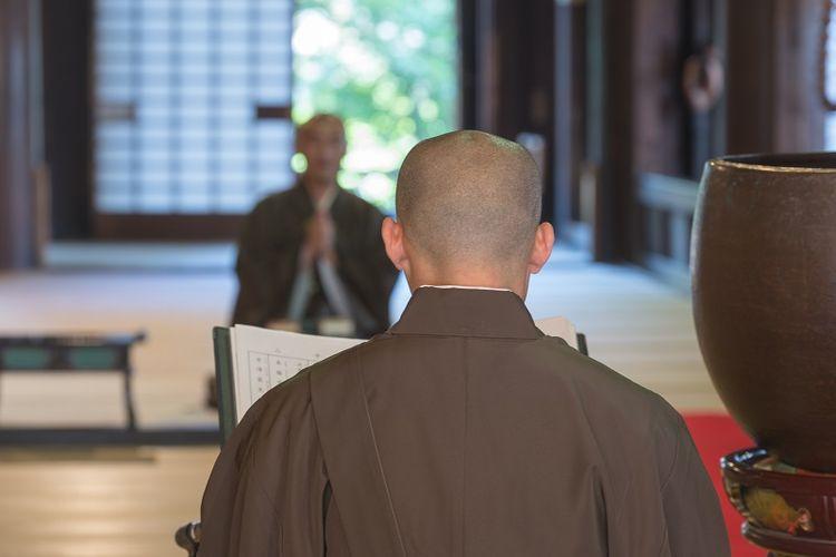 Japanese Monk praying in morning celemony at Kyoto Hyakumanben Chionji Temple