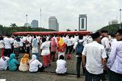 Apel HUT Jakarta Berlangsung, PNS Ngobrol dan Duduk di Barisan Belakang