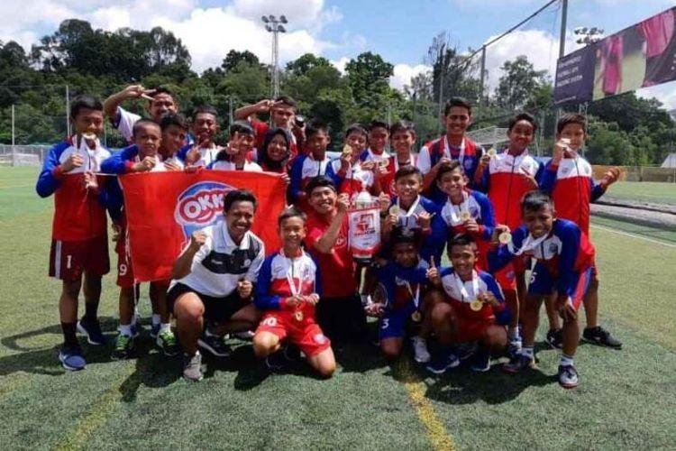 Okky Youth Soccer Team mengalahkan tim tuan rumah JSSL Singapura 7-2 di final rurnamen Singacup yang berlangsung 5-8 November.