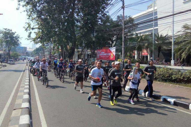 Lebih dari 70 karyawan KG menjadi partisipan pelari estafet pada Festival Jelang Obor Asian Games Kelurahan Gelora, Jakarta Pusat, Minggu (8/7/2018).