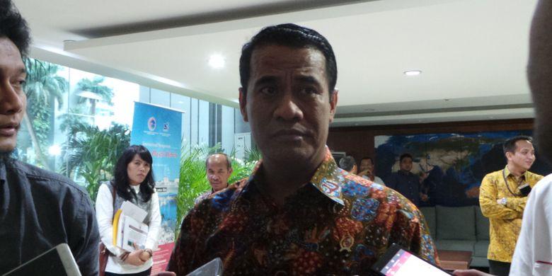 Menteri Pertanian Amran Sulaiman di kantor Kemenko Kemaritiman, Jakarta Pusat, Jumat (21/7/2017).