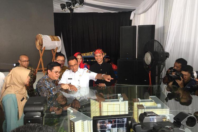 Gubernur DKI Jakarta Anies Baswedan meresmikan program DP 0 Rupiah di proyek Rusunami Klapa Village, Jakarta Timur, Jumat (12/10/2018).
