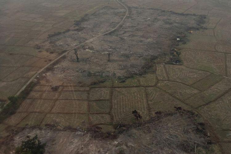 Foto udara ini diambil pada 9 Februari 2018 menunjukkan desa warga etnis Rshingya yang sudah diratakan dengan buldoser di Myanmar. (AFP)
