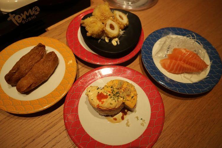 Hidangan sushi, sashimi, dan tempura di Tom Sushi.