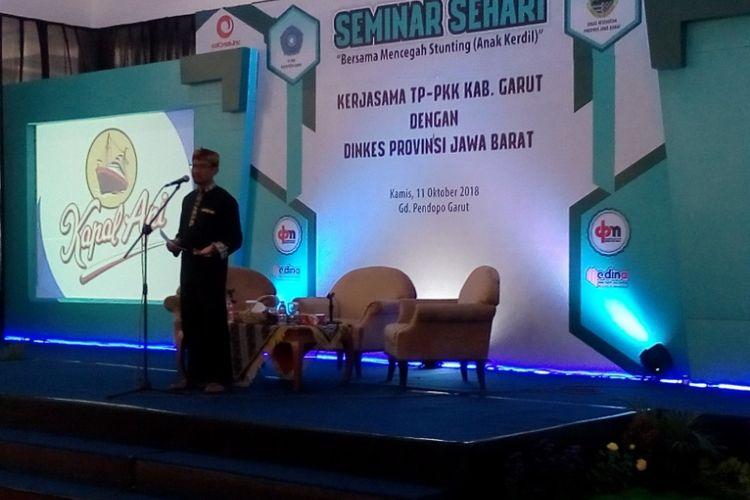 Wakil Bupati Garut Helmi Budiman saat membuka seminar tentang stunting di Pendopo Garut, Kamis (11/10/2018)