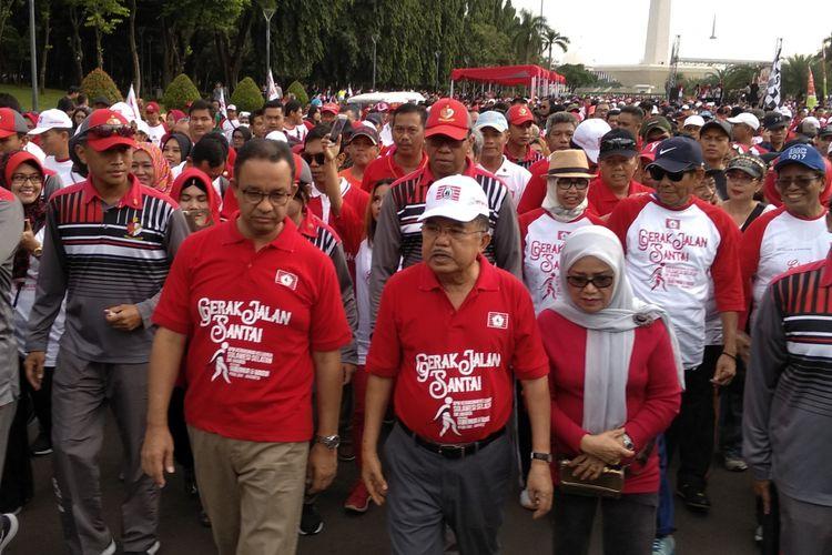 Gubernur DKI Jakarta Bersama Wakil Presiden RI ikuti jalan santai Kerukunan Keluarga Sulaweai Selatan, Minggu (25/3/2018)