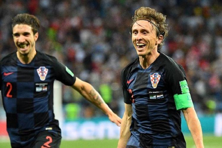 Kapten Kroasia, Luka Modric, merayakan golnya ke gawang Argentina pada pertandingan Grup D Piala Dunia 2019 di Nizhny Novgorod, 21 Juni 2018.