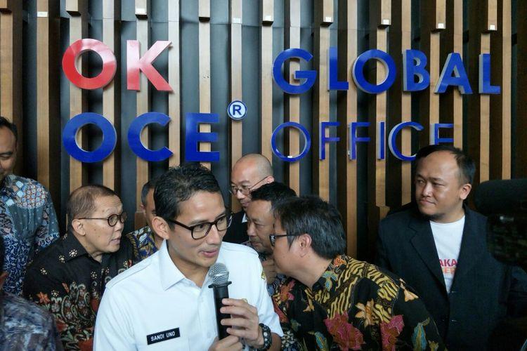Wakil Gubernur DKI Jakarta Sandiaga Uno meresmikan OK OCE Global Office di Jalan Epicentrum Tengah, Rabu (14/2/2018).