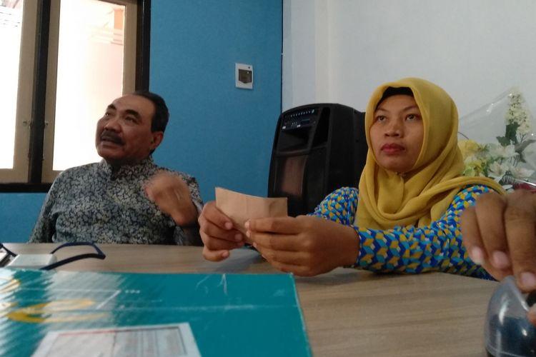 Baiq Nuril datang ke Polda NTB untuk menjalani pemeriksaan sebagai pelapor, Jumat (23/11/2018).